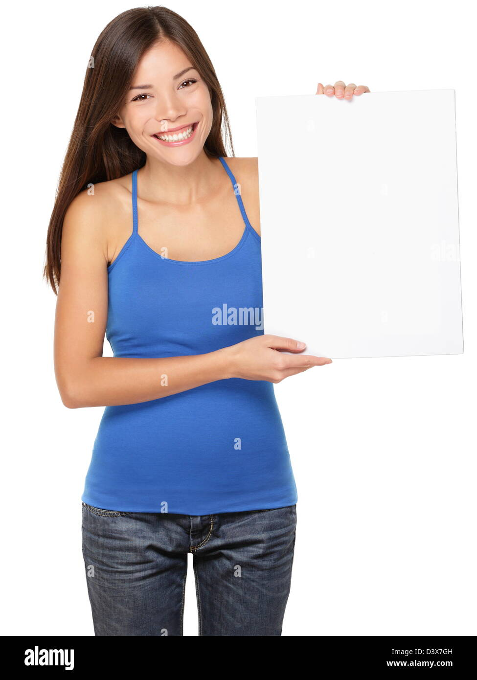 Happy asian woman showing white blank paper placard isolated on white background - Stock Image