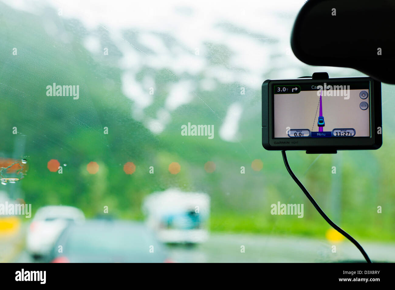 Windshield view of GPS and Anton Anderson Memorial Tunnel under Maynard Mountain, shared by automobiles and the - Stock Image