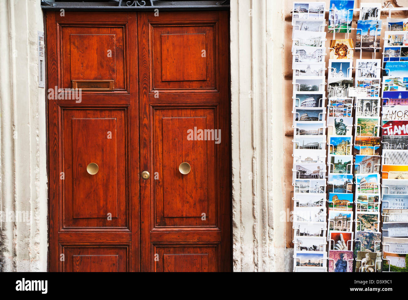 Postcards for sale at the side of a house, Rome, Lazio, Italy - Stock Image