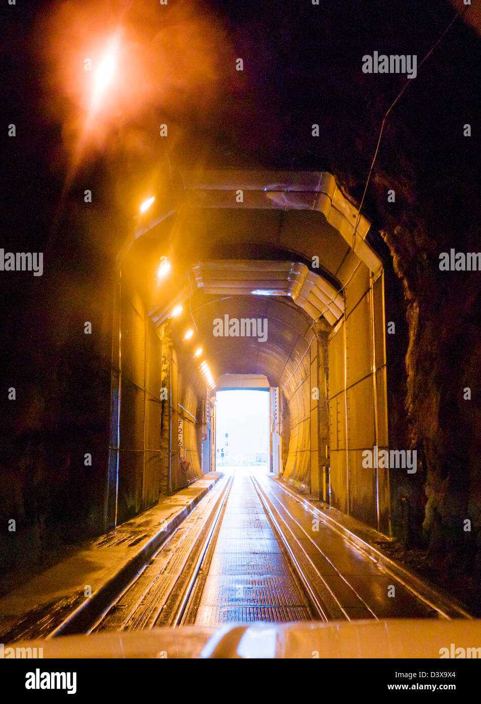 The Anton Anderson Memorial Tunnel under Maynard Mountain is shared by automobiles and the railroad.  Whittier to - Stock Image