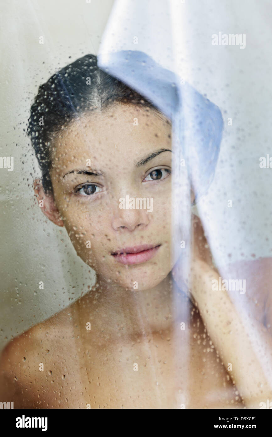 Portrait of beautiful mixed race Caucasian / Asian young shower woman bathing in bathroom Stock Photo
