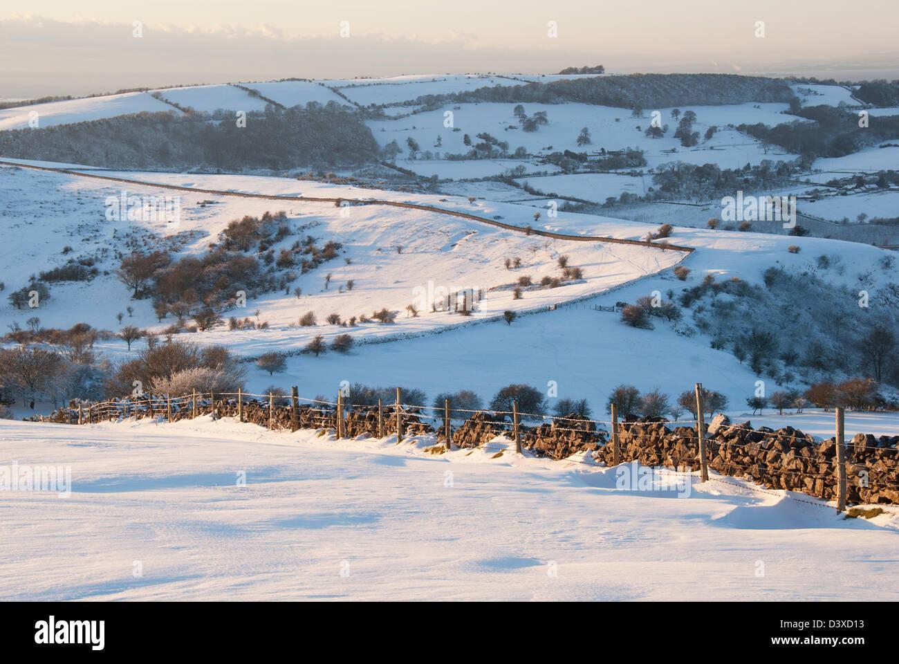 Stone wall and snowdrift, England, United Kingdom, Europe - Stock Image