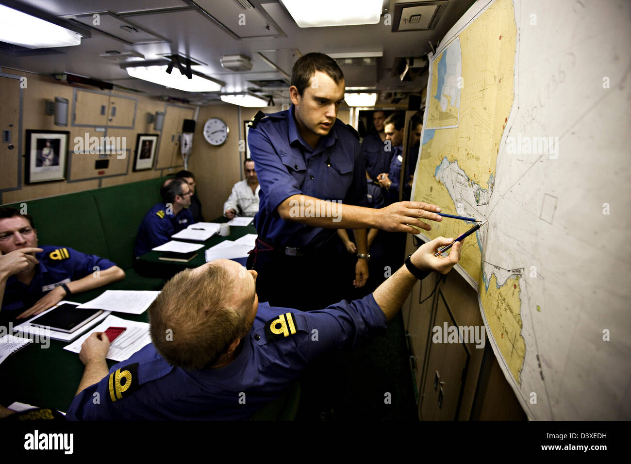 Crew plotting position on map in Nuclear Submarine HMS Talent - Stock Image