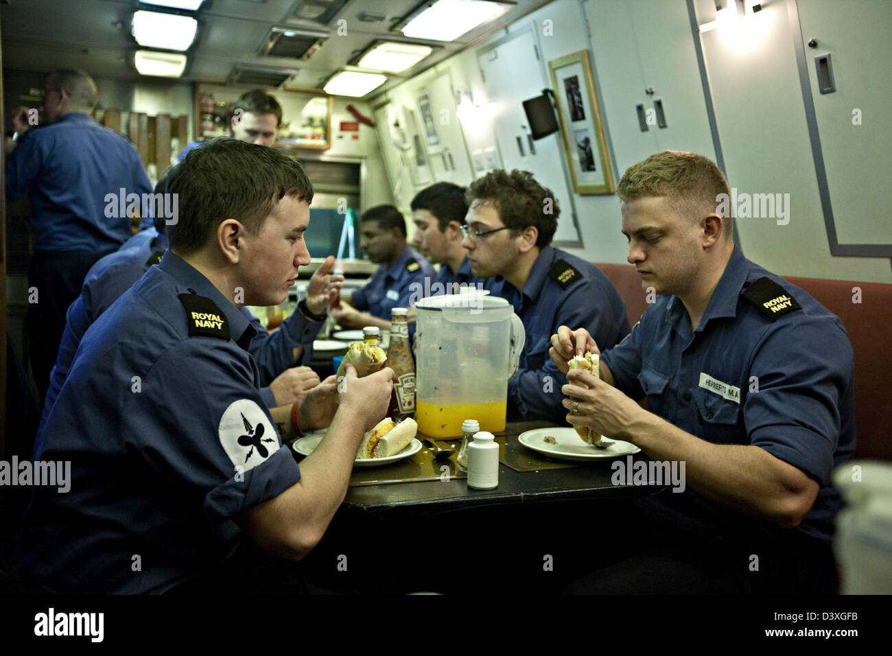 Crew eating in galley mess of Nuclear Submarine HMS Talent - Stock Image