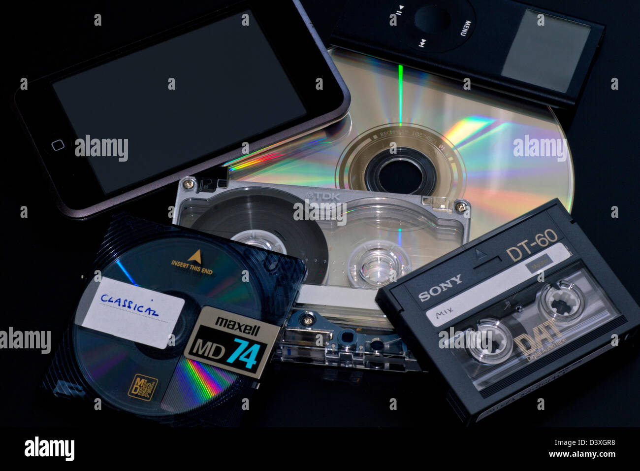Audio formats: (clockwise fromtop left)  iPod Touch, iPod Mini, CD, Digital Audio Tape (DAT), Cassette Tape (metal), - Stock Image