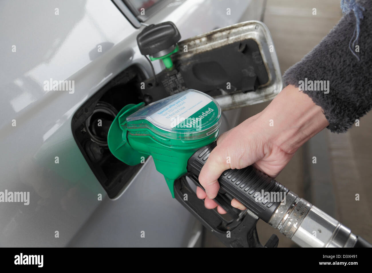 A person filling a car with unleaded petrol, Scotland, UK - Stock Image