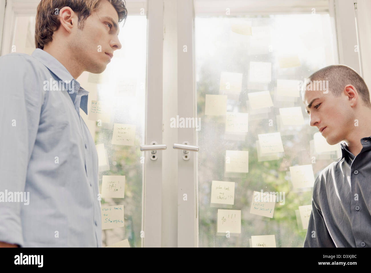 two office workers in discord, not seeing eye-to-eye - Stock Image