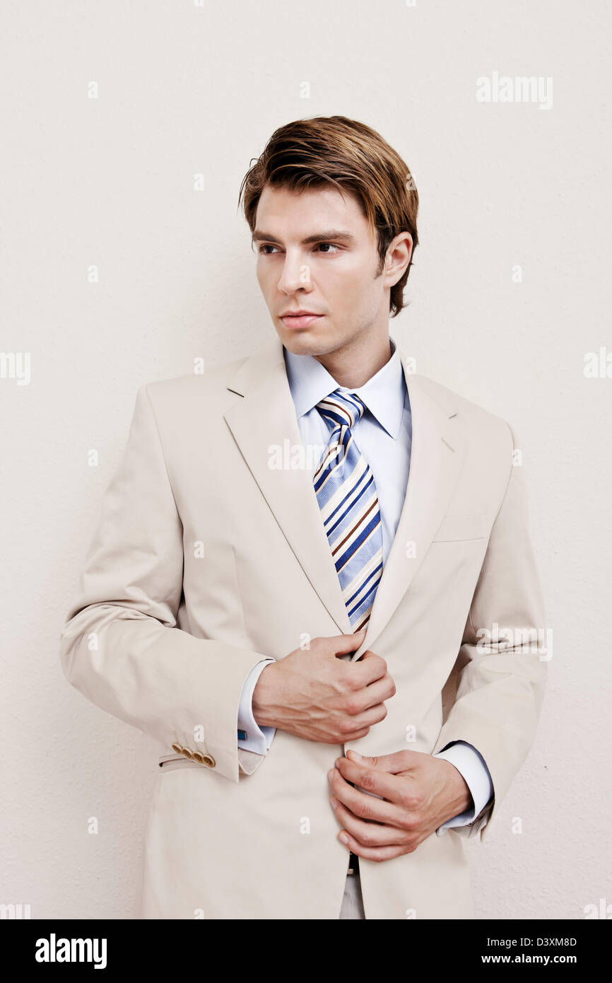 stock fashion photo of man in beige summer cotton suit - Stock Image