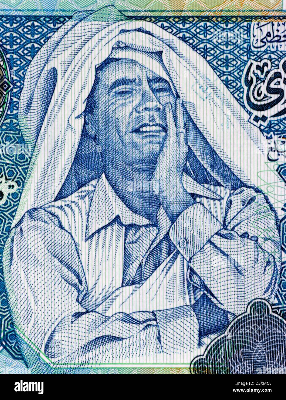 Muammar Gaddafi (1942-2011) on 1 Dinar 2004 Banknote from Libya. Ruler of Libya during 1969-2011. - Stock Image