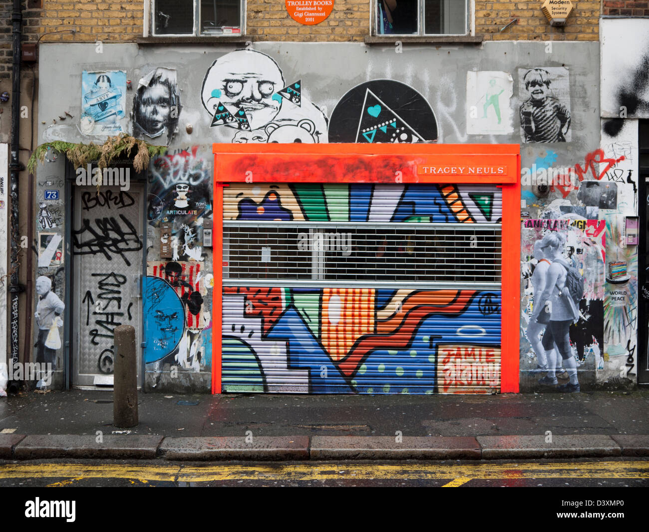Colourful Shop Front Covered In Graffiti And Street Art In Redchurch Street East London