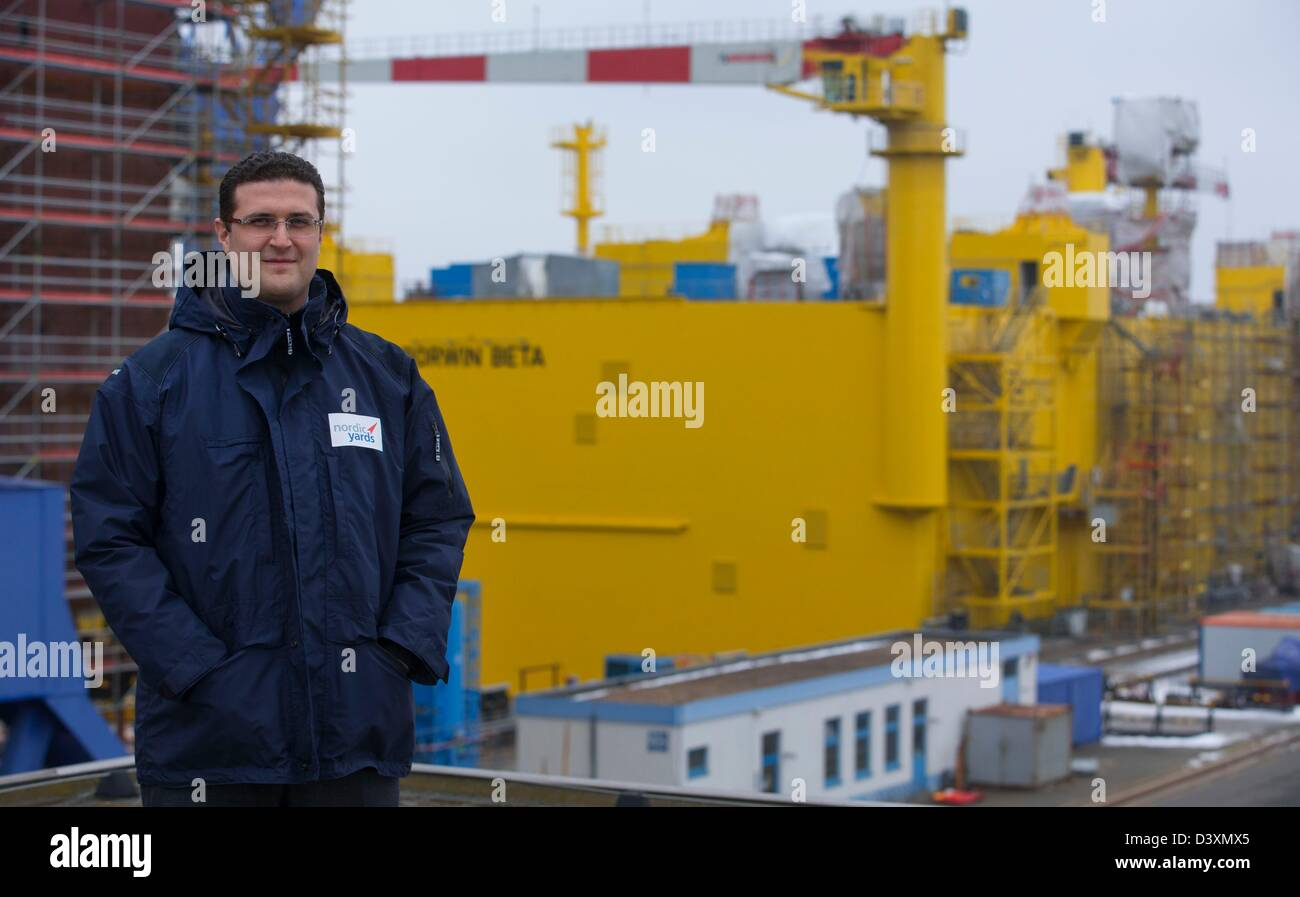 The owner and manager of Nordic Yards, the Russian Vitaly Yusufov, stands in front of the offshore platform BorWin - Stock Image