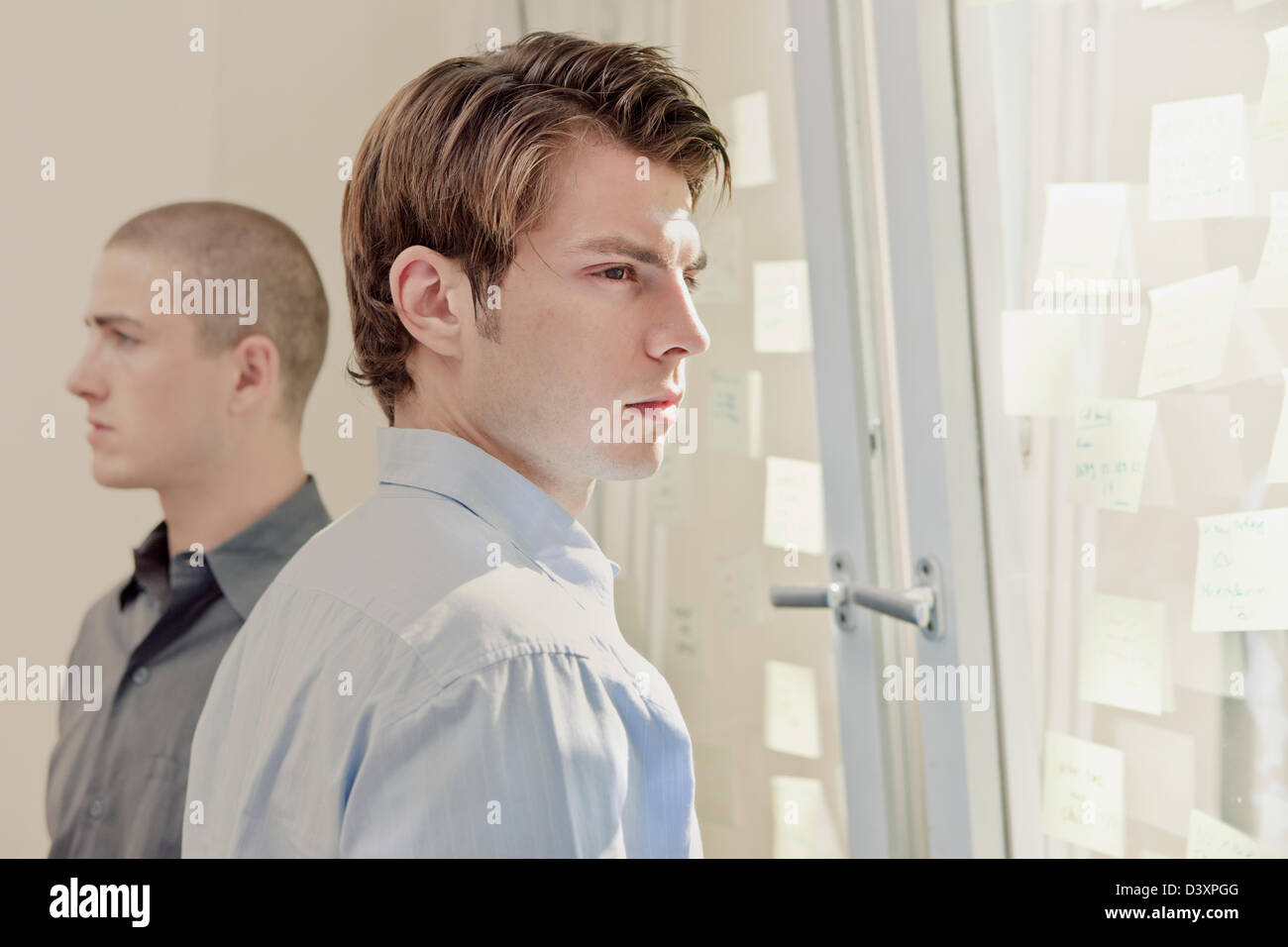concept photo of two office workers in discord and rivalry - Stock Image