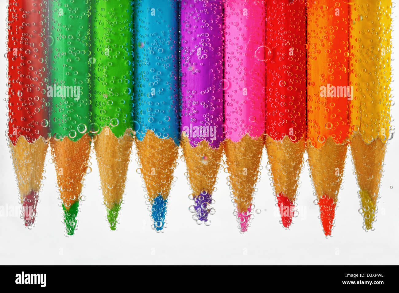 colored pencils in water - Stock Image