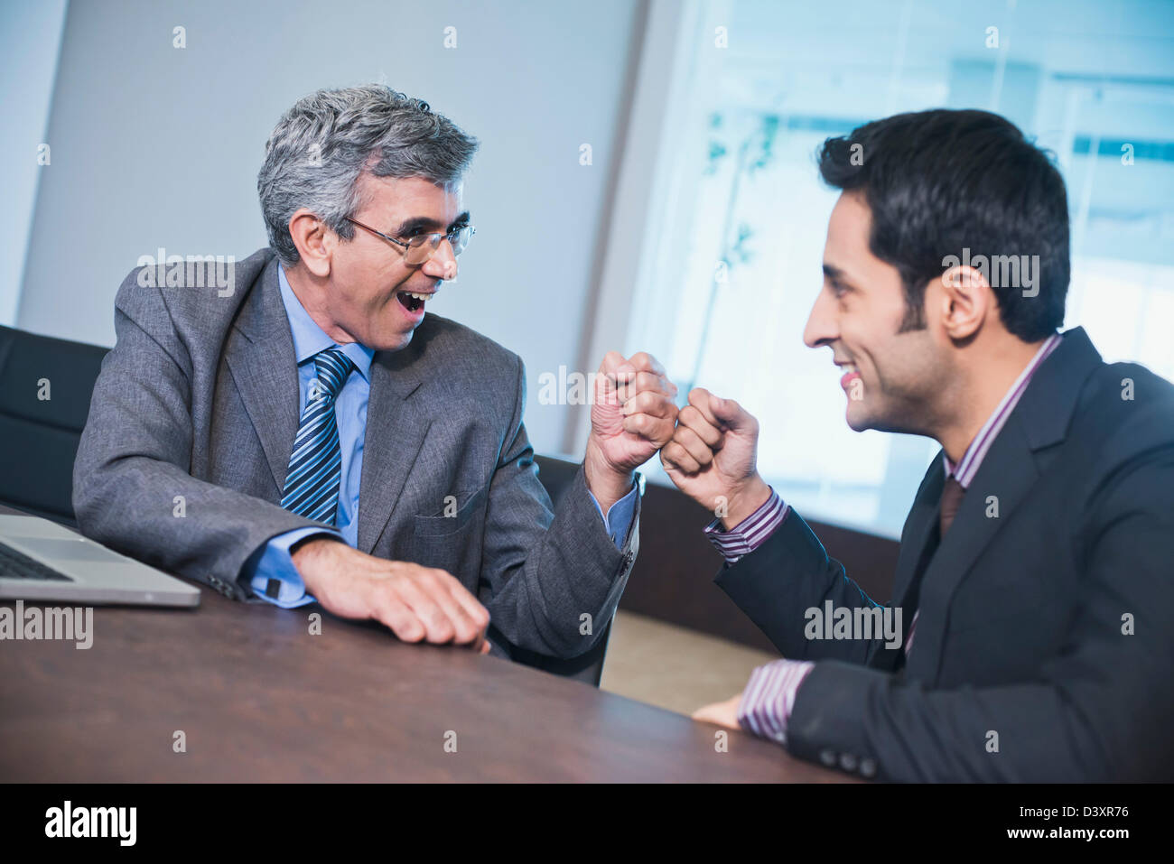 Young men greeting other fist stock photos young men greeting business fist bump m4hsunfo