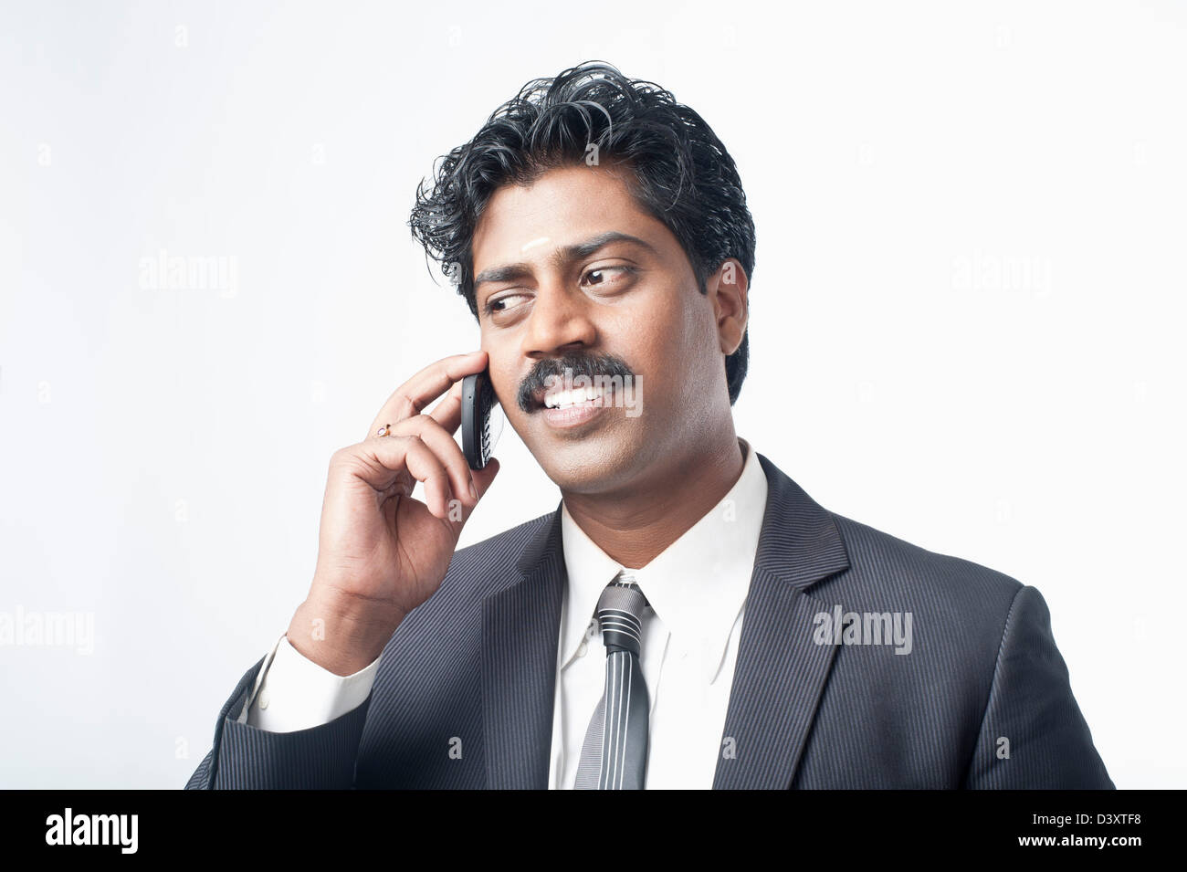 044ea9354f South Indian businessman talking on a mobile phone Stock Photo ...