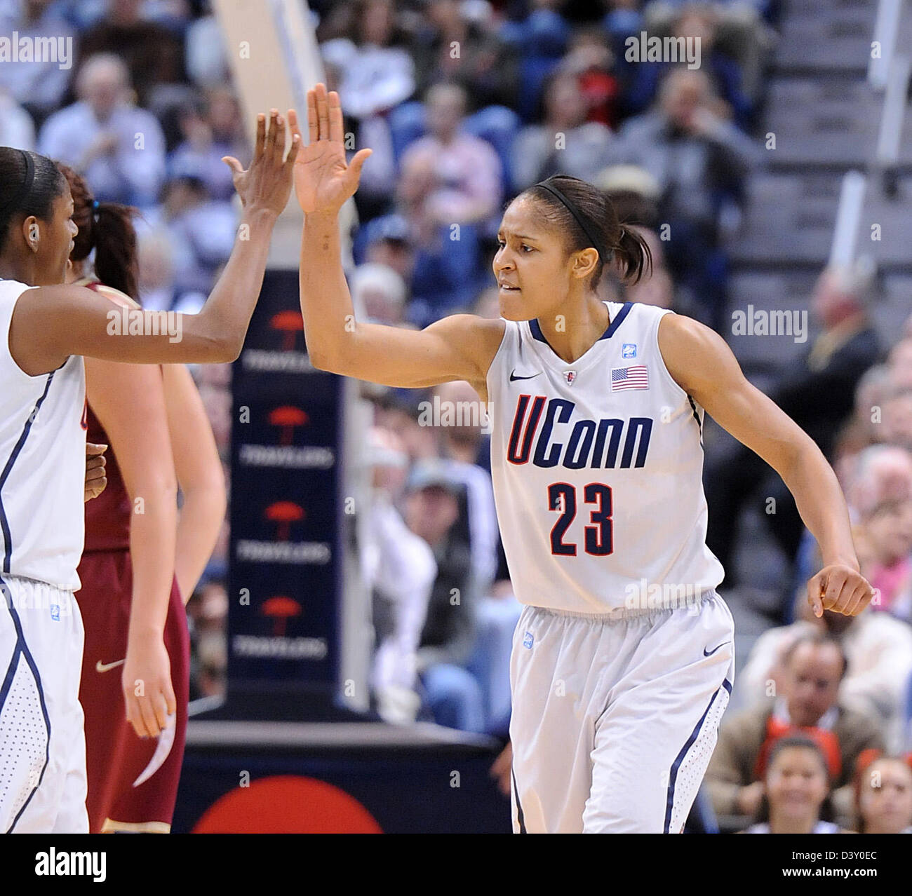 Hartford-- UCONN's Maya Moore gets a high-five from Tiffany Hayes after a basket during the first half. UCONN - Stock Image