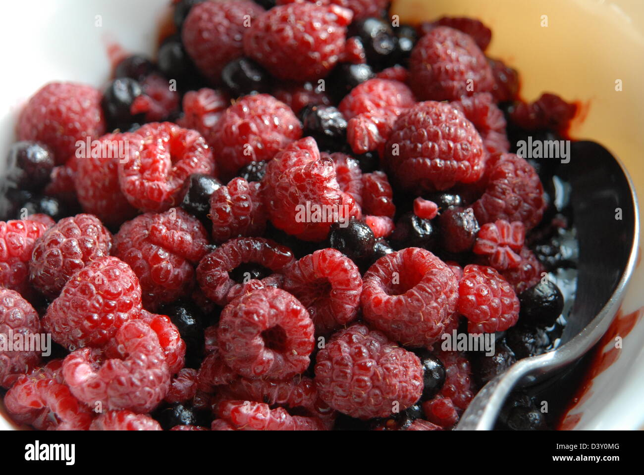 Raspberries and blueberries, healthy dessert. - Stock Image