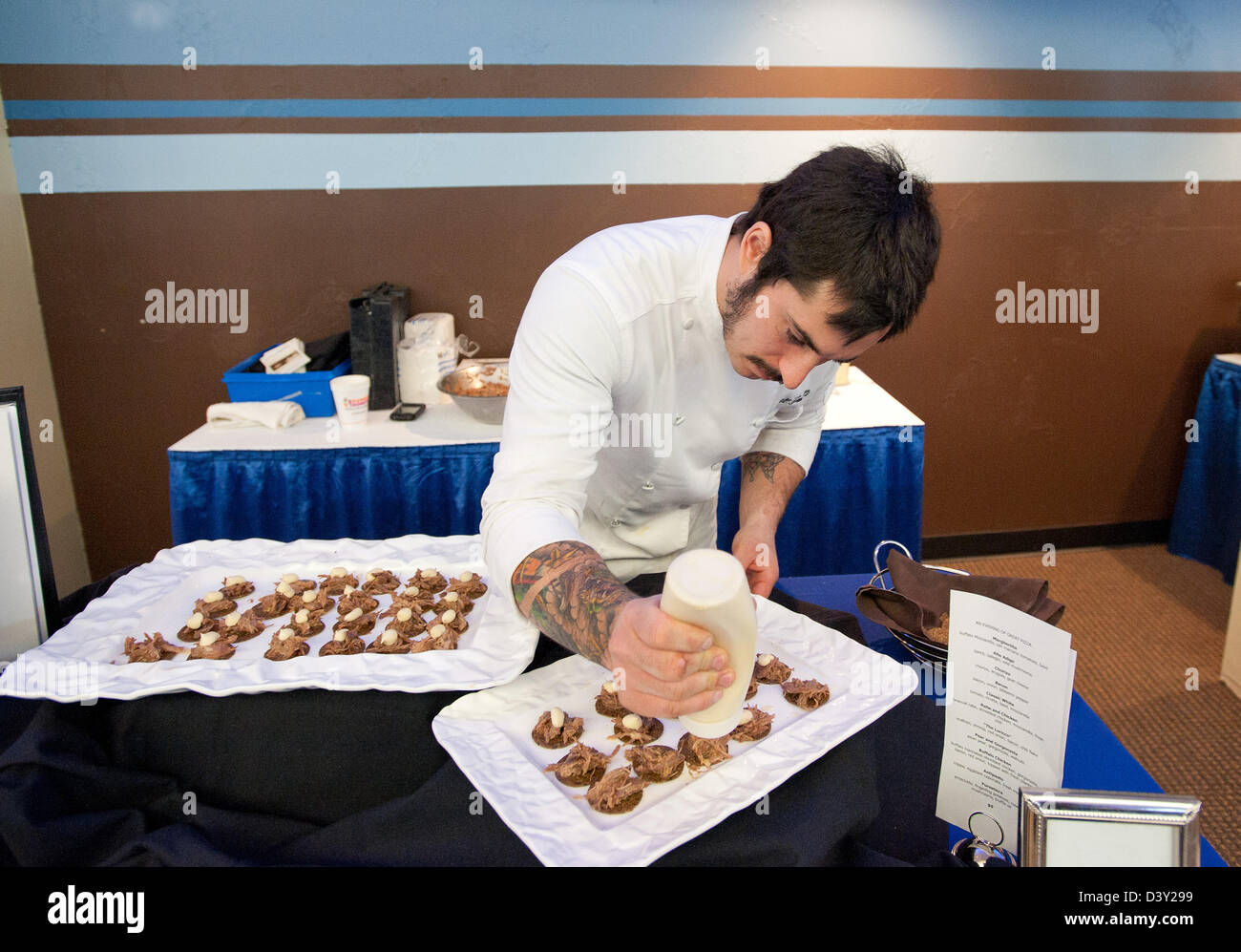 Chef making duck appetizers during a business expo in the USA - Stock Image