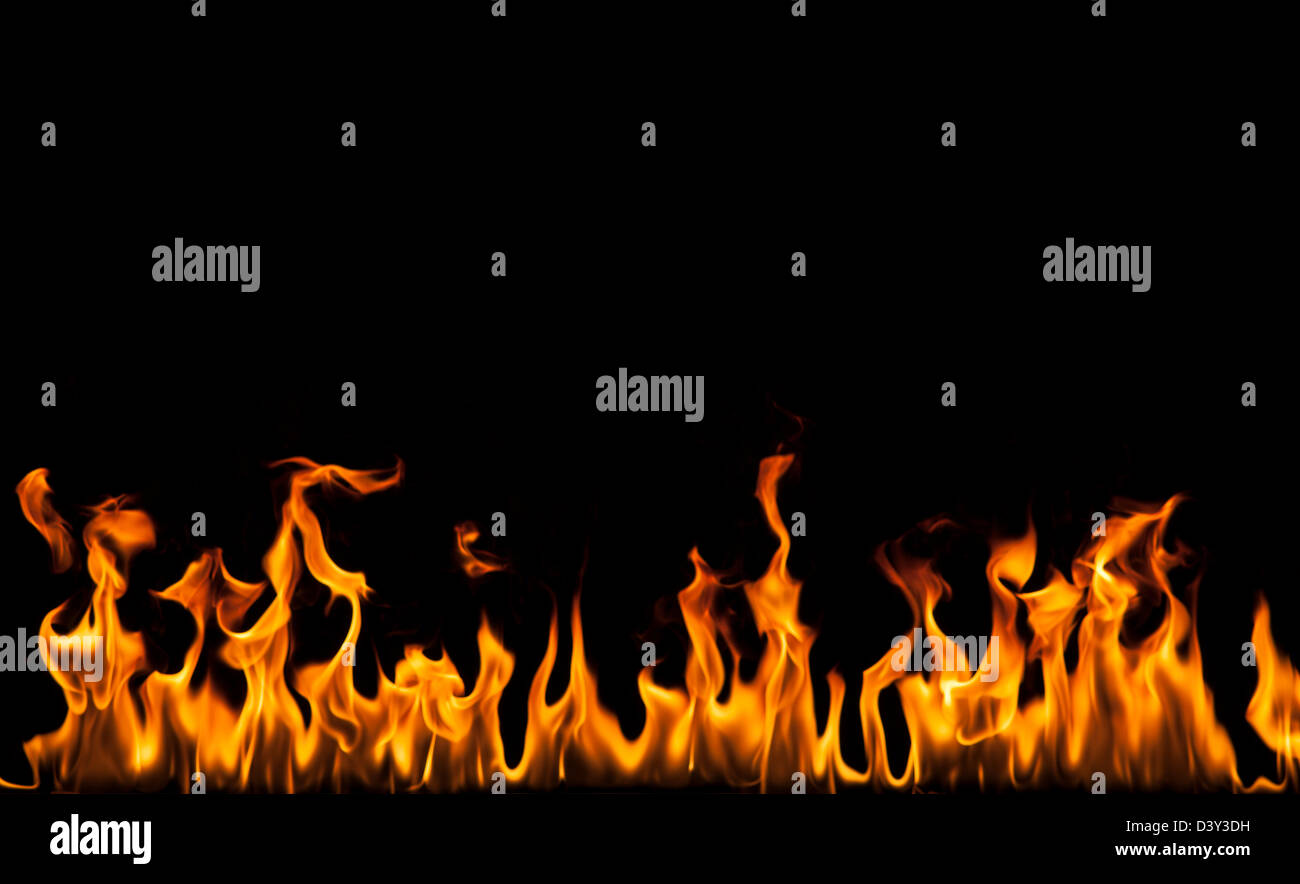 Fire against a black background - Stock Image