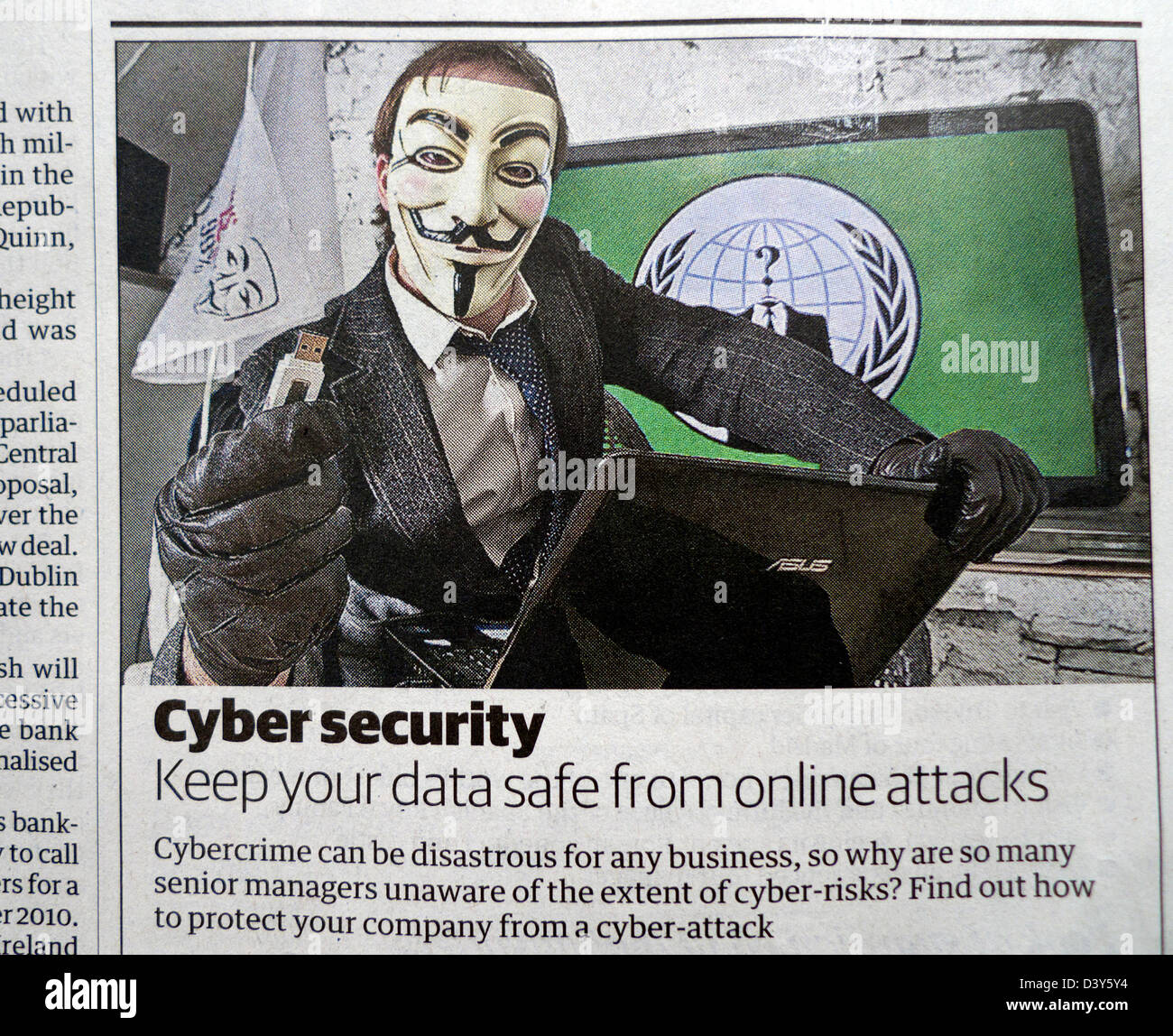 Cyber security newspaper advertisement with Anonymous hacker and memory stick UK - Stock Image