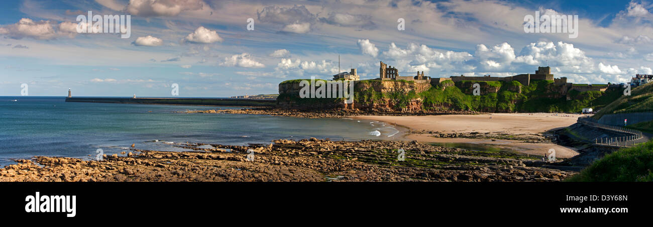 A panoramic view in the evening of Tynemouth Castle and Priory as seen from King Edwards Bay looking south towards - Stock Image