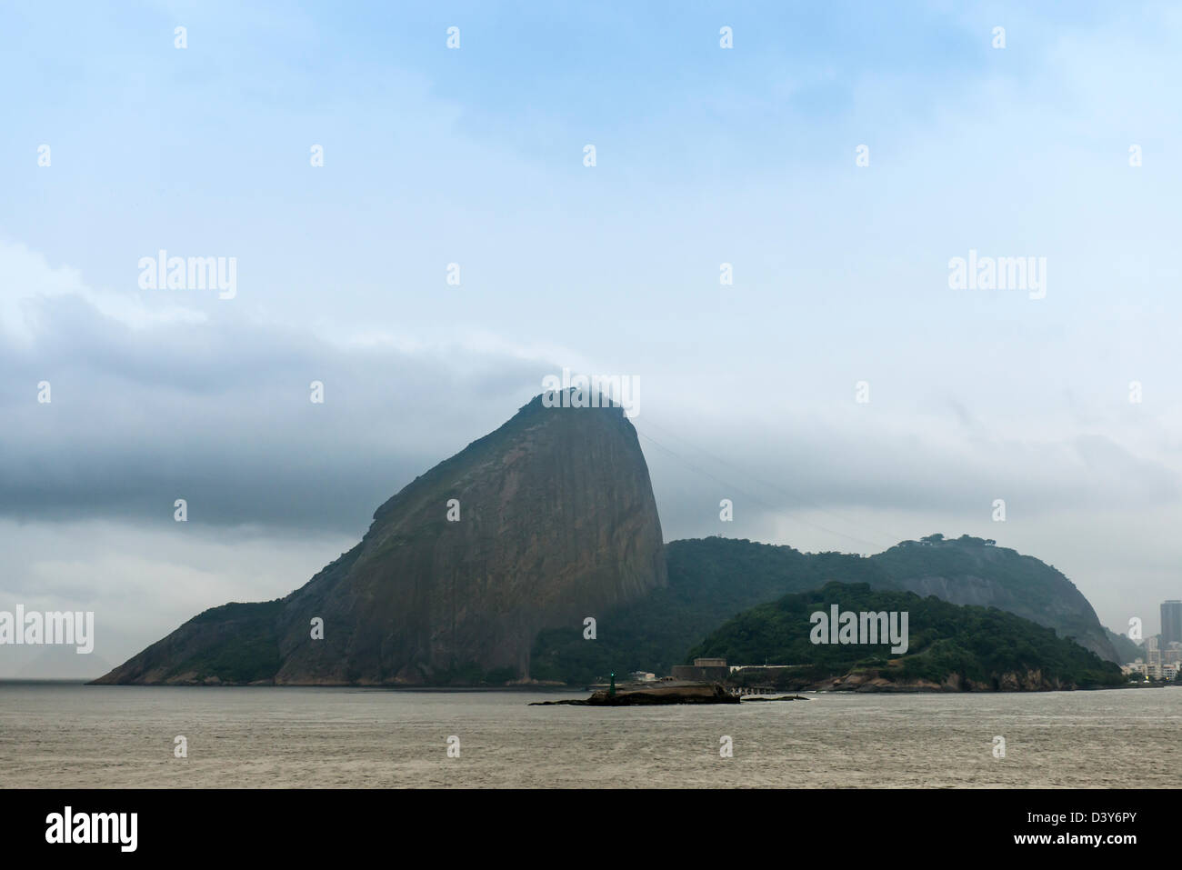 view of sugar loaf in Rio de Janairo Brazil with clouds streaking from te op Stock Photo