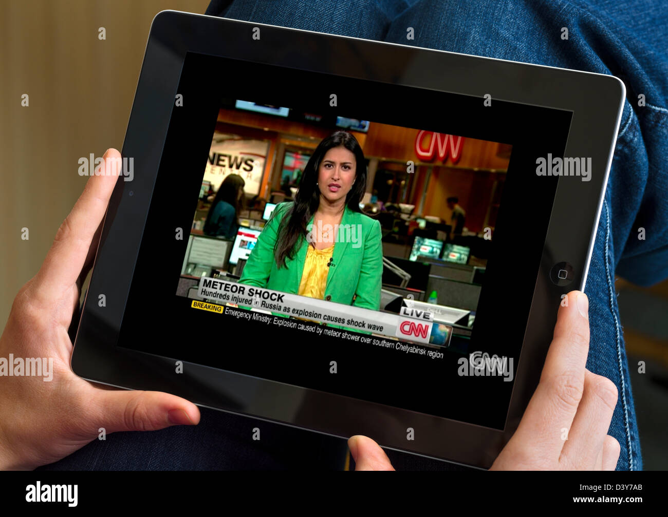 Watching a news broadcast on the CNN News website via a 4th generation Apple iPad - Stock Image