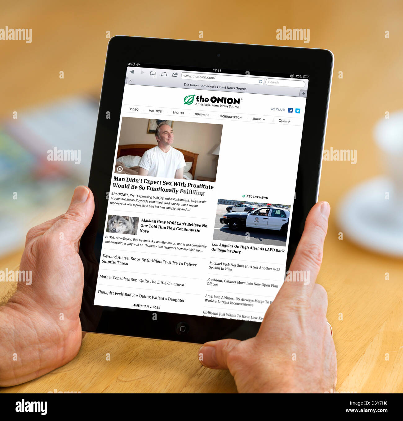 The satirical website, The Onion, viewed on a 4th generation Apple iPad, USA - Stock Image