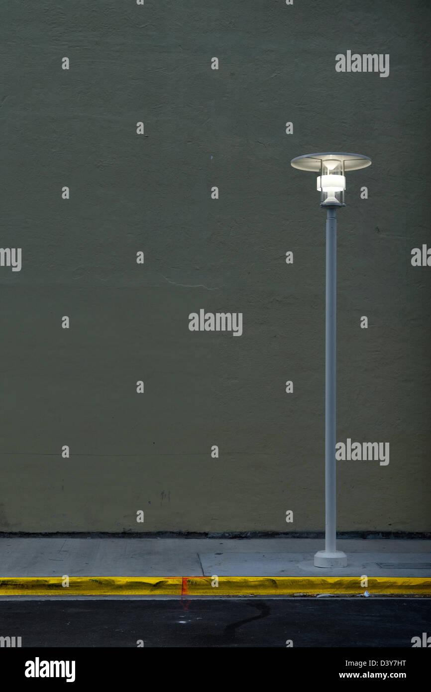 A streetlight on an empty South Beach Miami street. - Stock Image