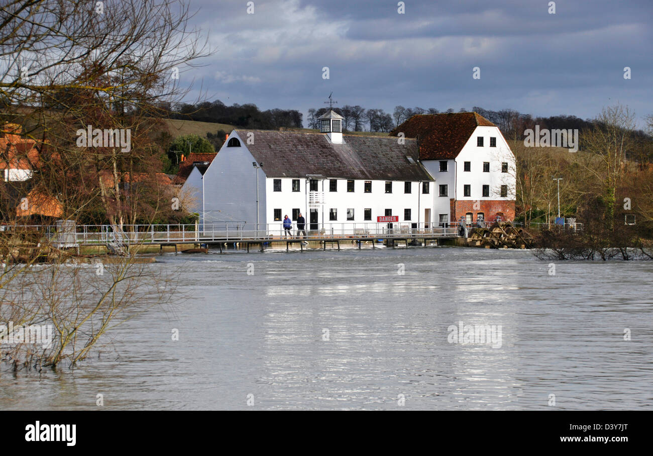 Bucks - Hambleden Mill End on the Thames - the mill and weir - spotlight of winter sun - the river in flood - Stock Image