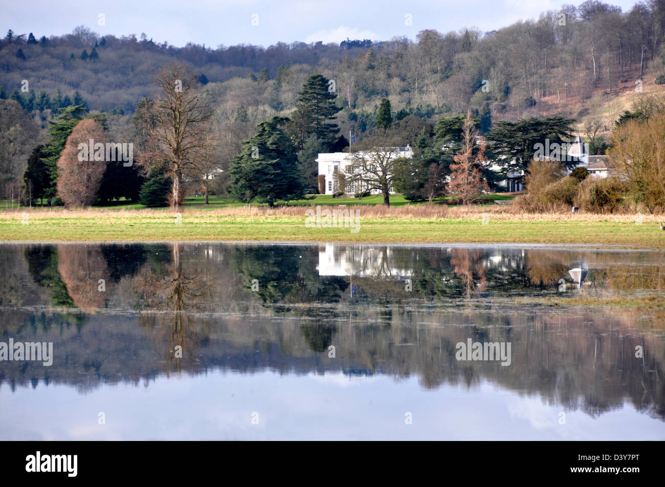 Bucks - Hambleden - river Thames at Mill End - unique reflections in a flooded field Greenlands - mansion circa - Stock Image