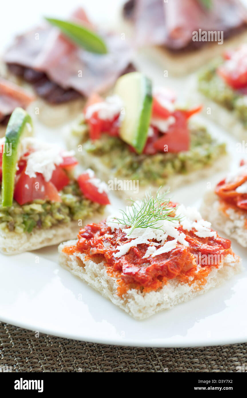 Little bite size healthy appetizers with tapanade - Stock Image