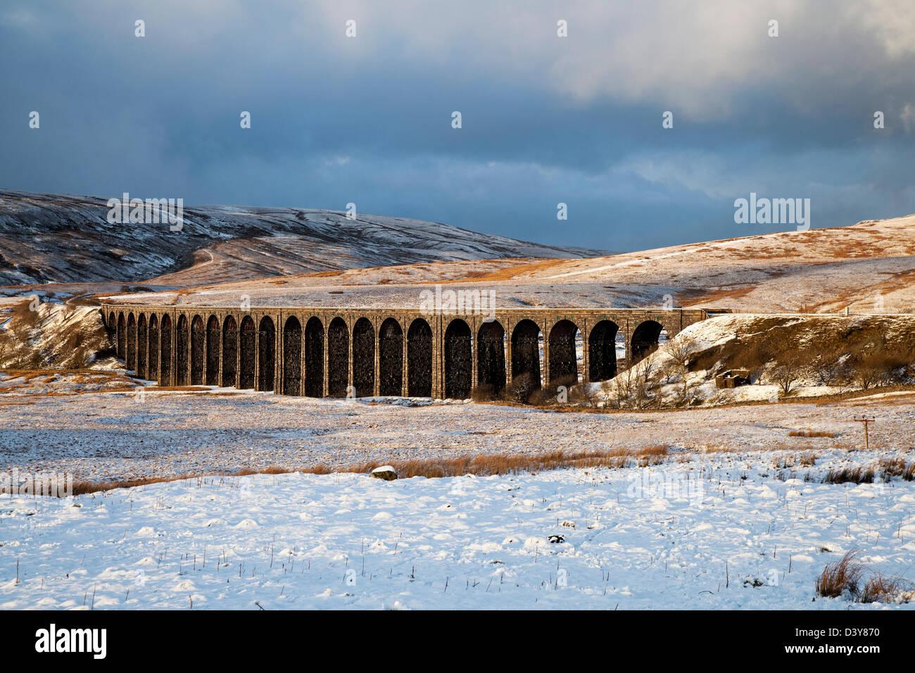 Settle-Carlisle Railway and the Ribblehead Viaduct and winter sunset, Ingleborough, Yorkshire, UK - Stock Image