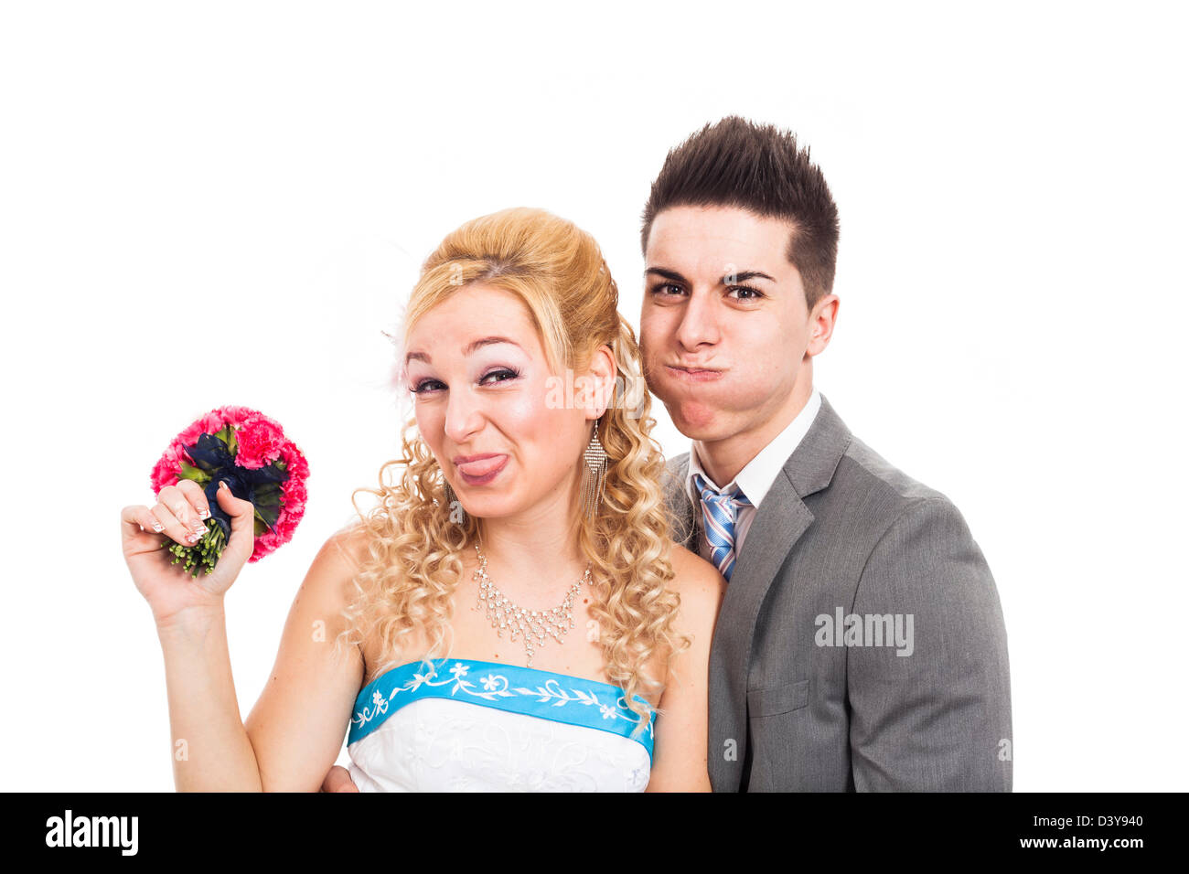 Wedding couple making funny faces, isolated on white background. - Stock Image