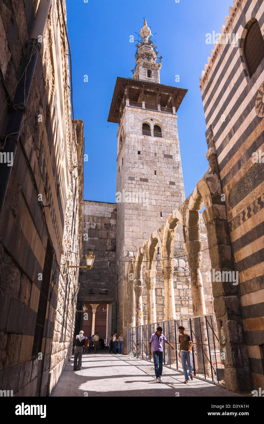 Minaret of the Bride, the oldest of the Umayyad Mosque as seen from an alley in the old town. Damascus, Syria - Stock Image