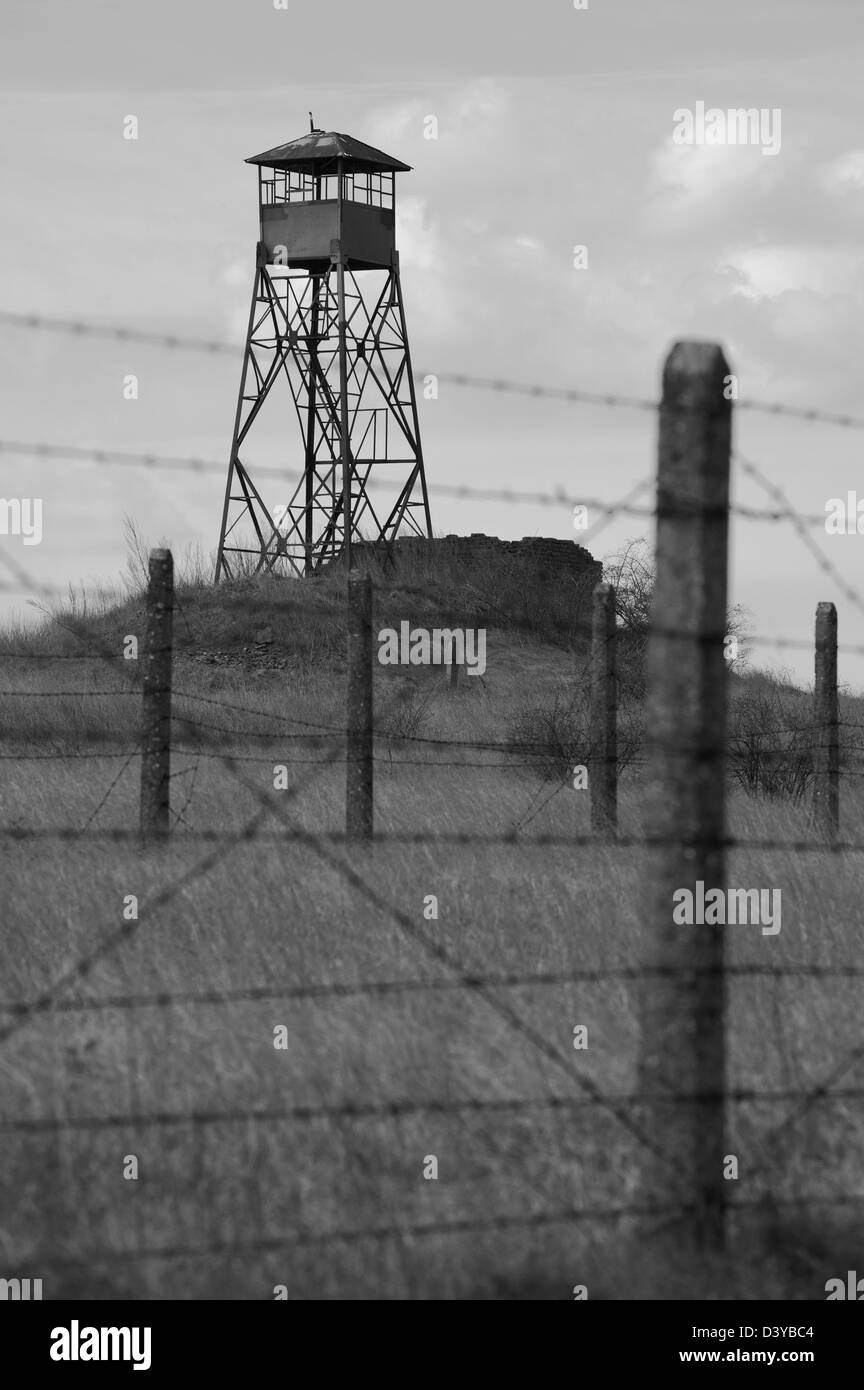 Military zone with old sentry box and barbed wire - Stock Image