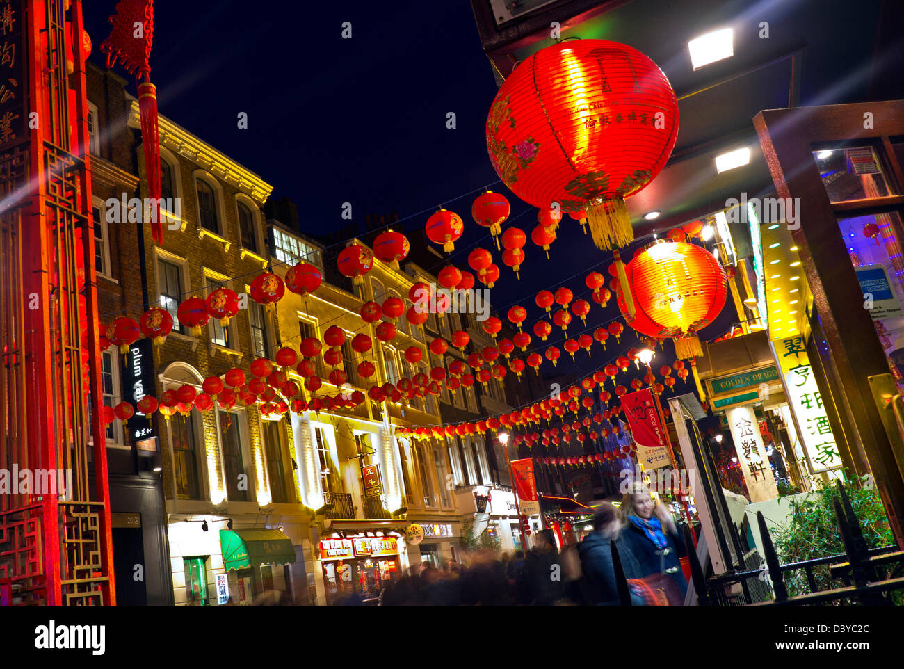 Chinese New Year Restaurant lanterns lit up on a busy night in Chinatown Soho London UK - Stock Image
