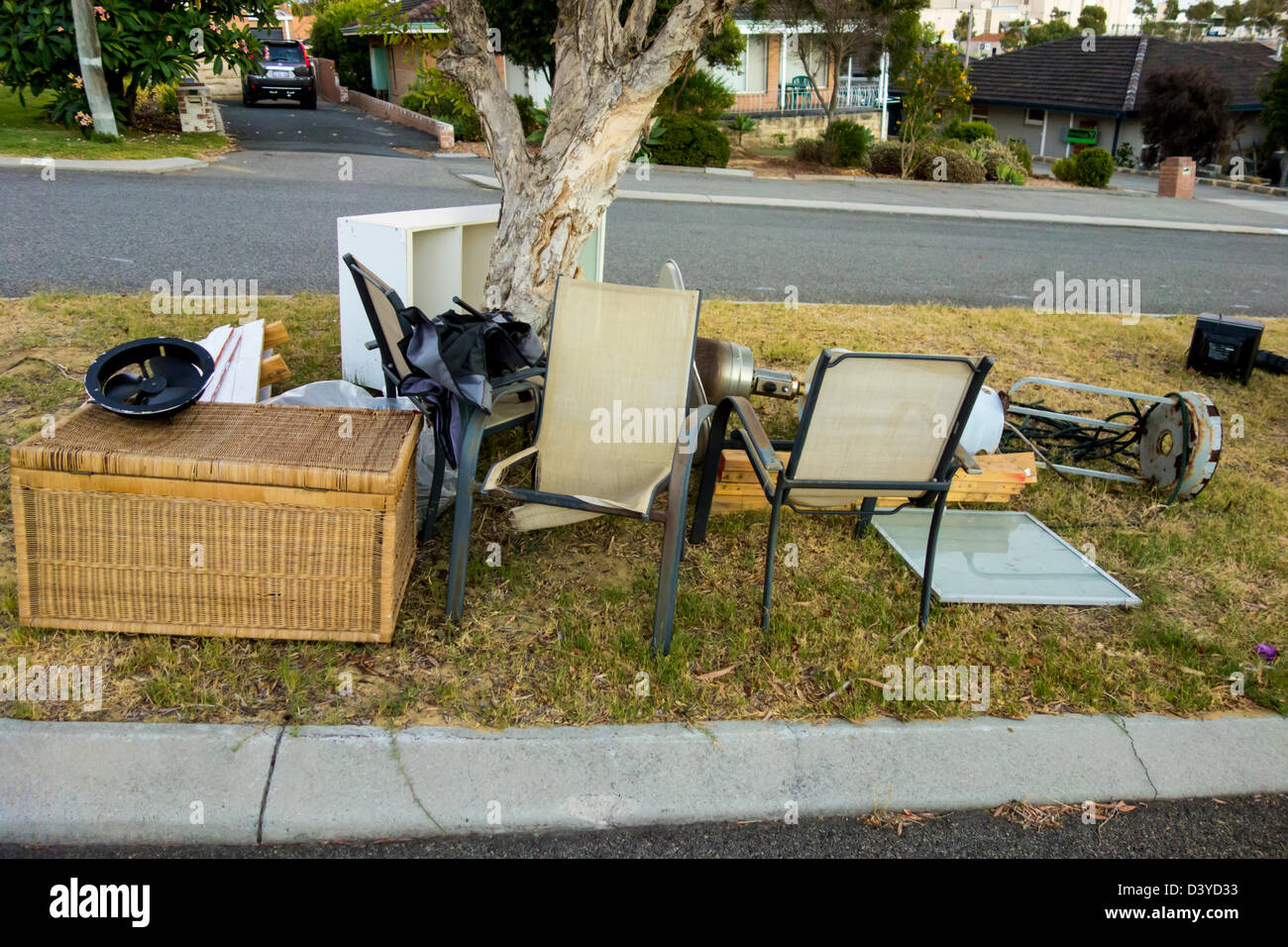 House junk ready to be collected on verge - Stock Image