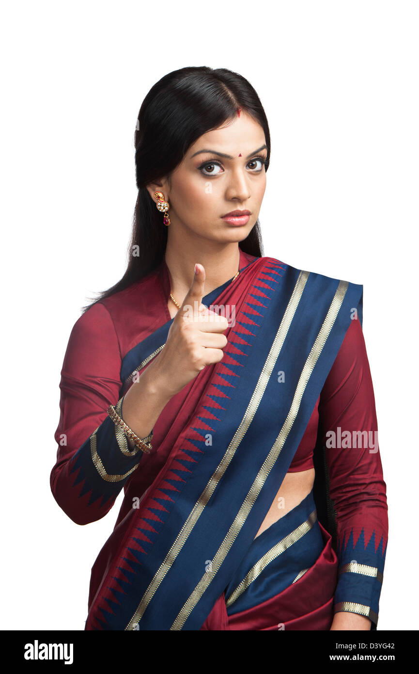 Traditionally Indian woman pointing Stock Photo
