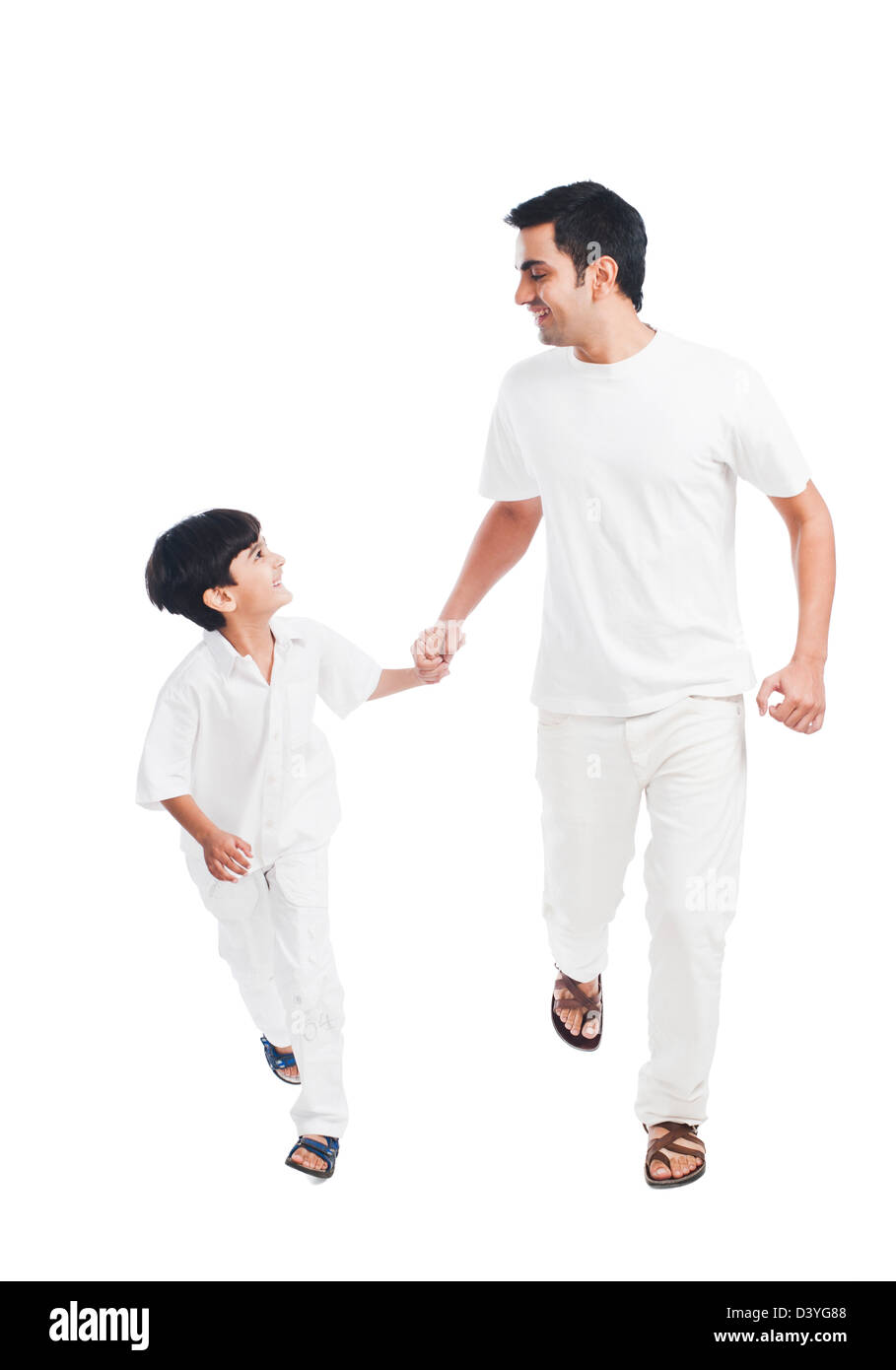 Happy father and son holding hands - Stock Image
