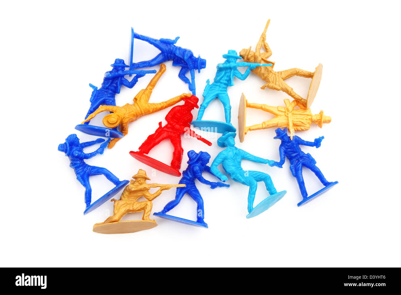 An assortment of toy cowboys and in a loose pile on white background. - Stock Image