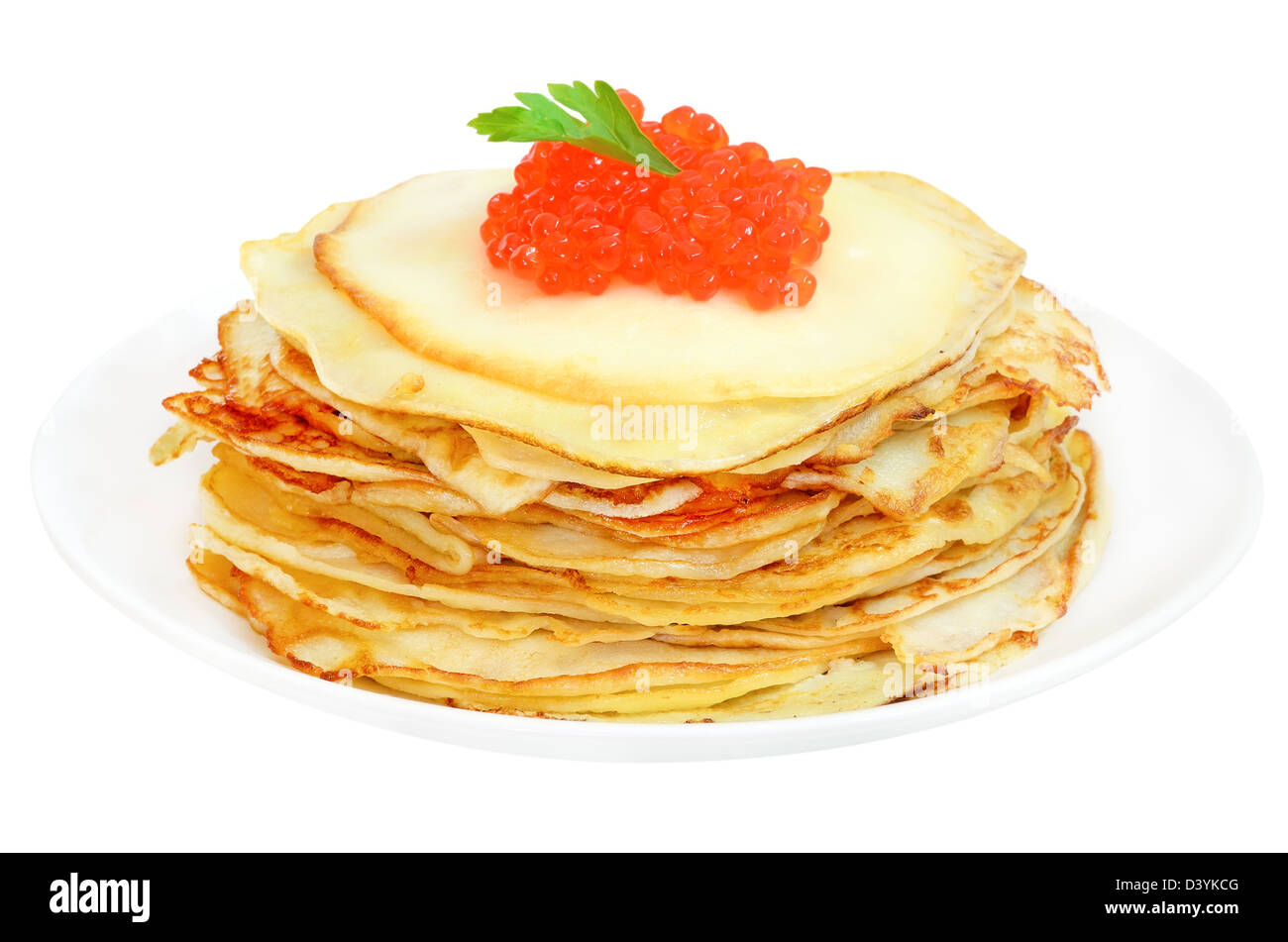 Pancakes with red caviar on a plate isolated on white background - Stock Image