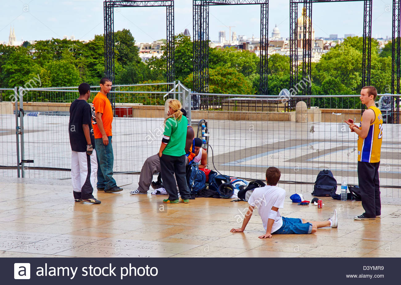 group of young teenagers on the trocadero in paris - Stock Image