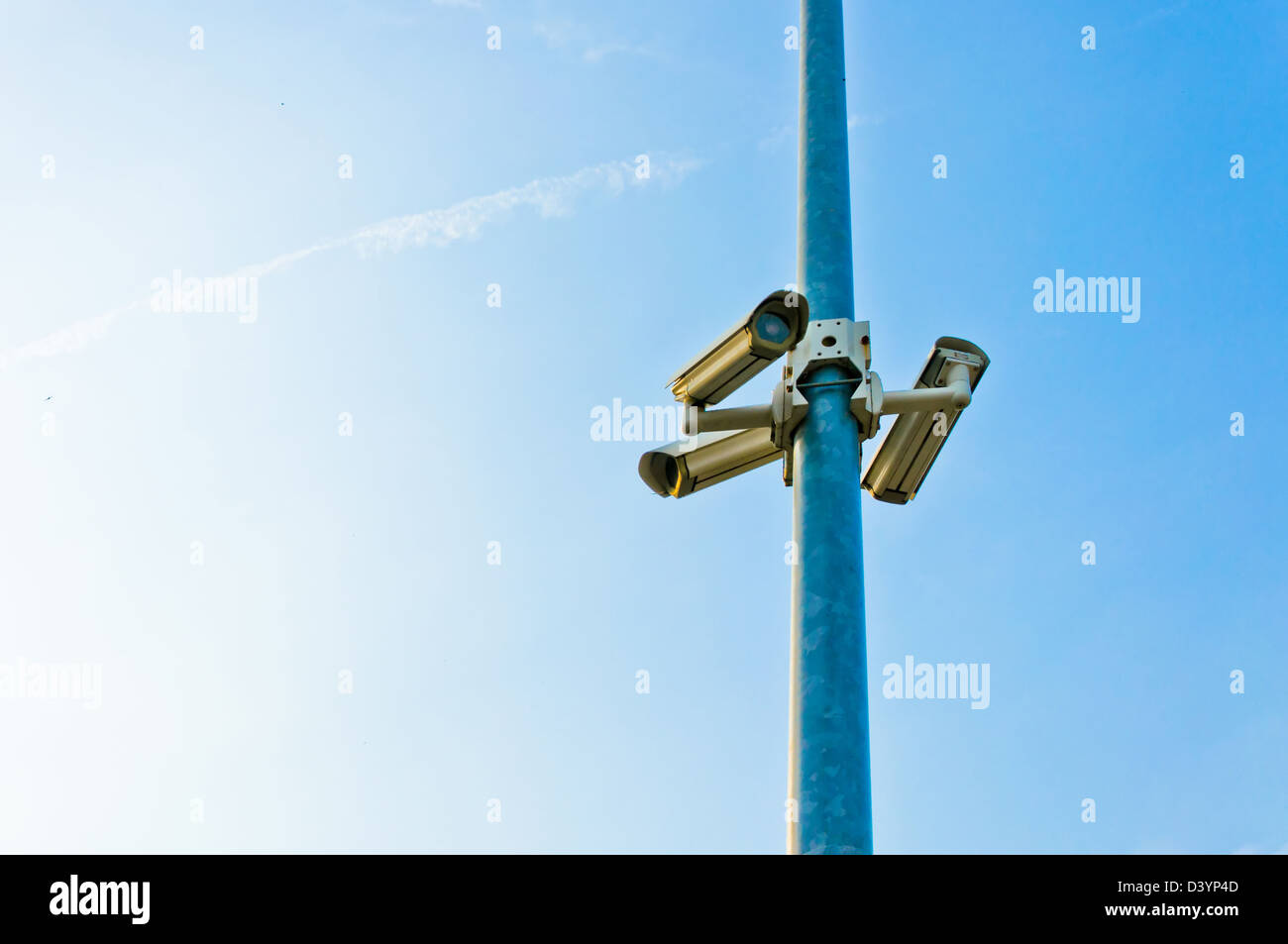 security cctv cameras on a pole with blue sky background - Stock Image