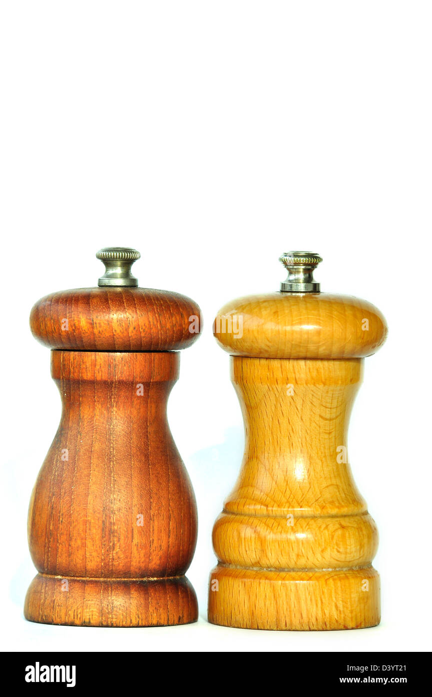 A pair of wooden pepper and salt cellars - Stock Image