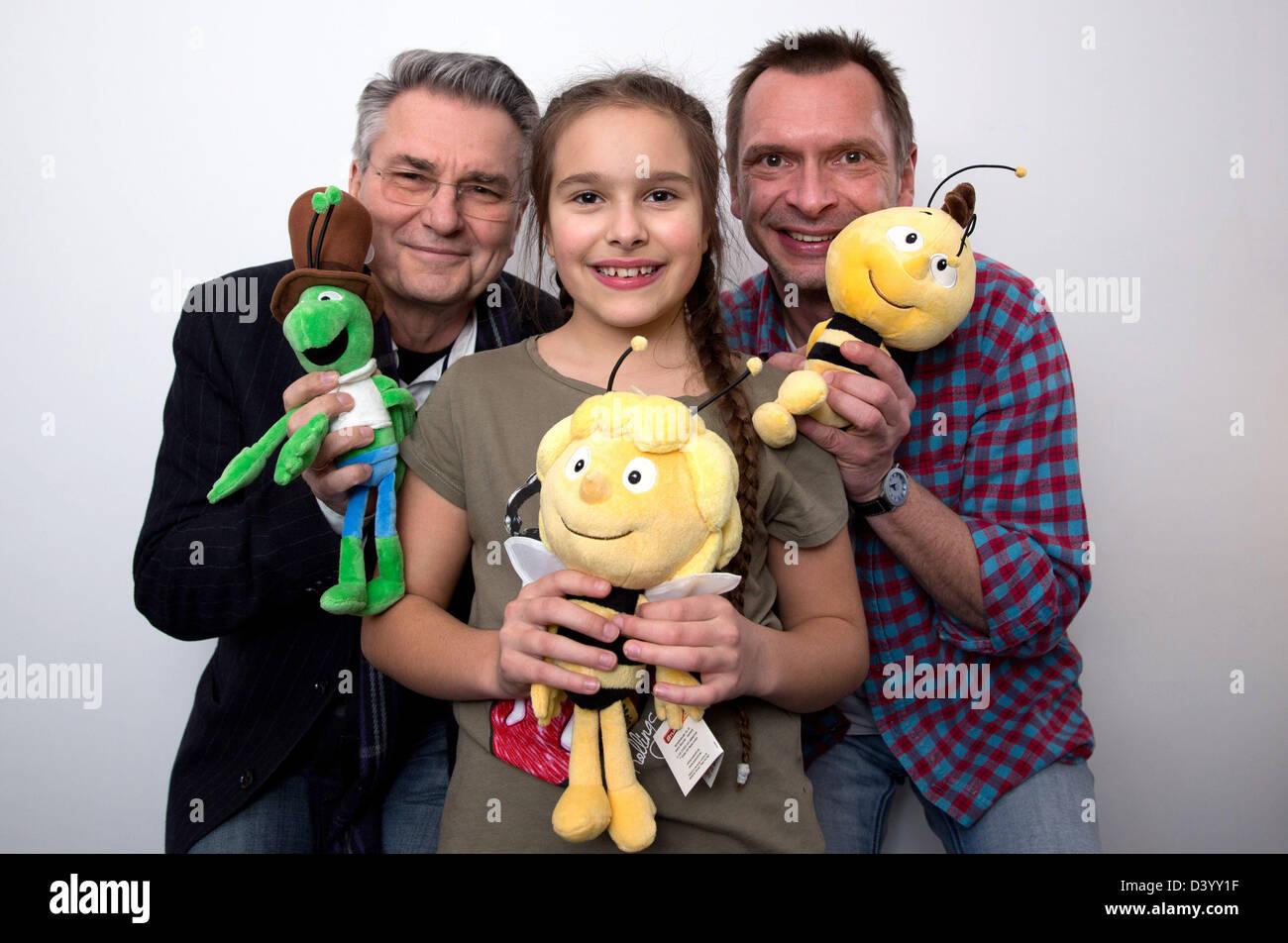 Voice actors Hans-Juergen Dittberner (FLIP, L-R), Zalina Sanchez (Maya the Bee) and Gerd Meyer (Willi) pose on the - Stock Image