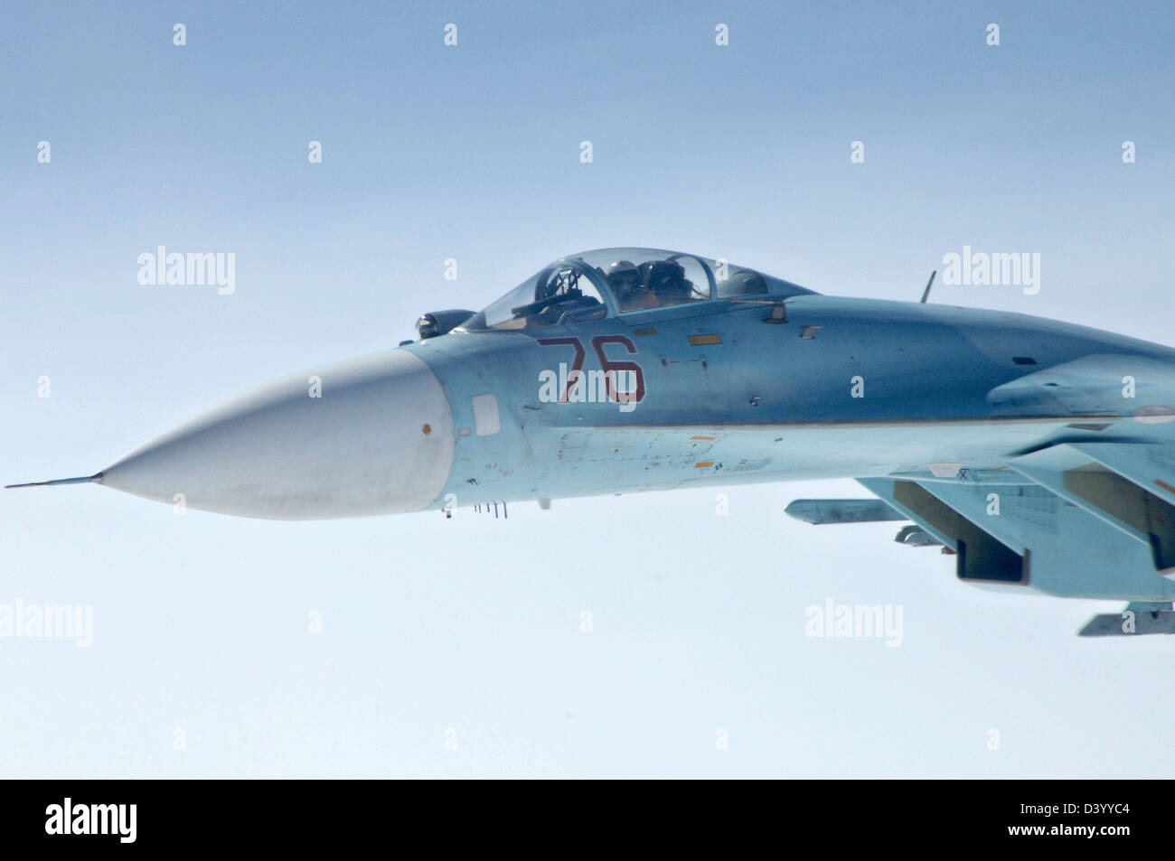A Russian SU-27 fighter aircraft escorts a simulated hijacked airliner during a joint training exercise with US - Stock Image