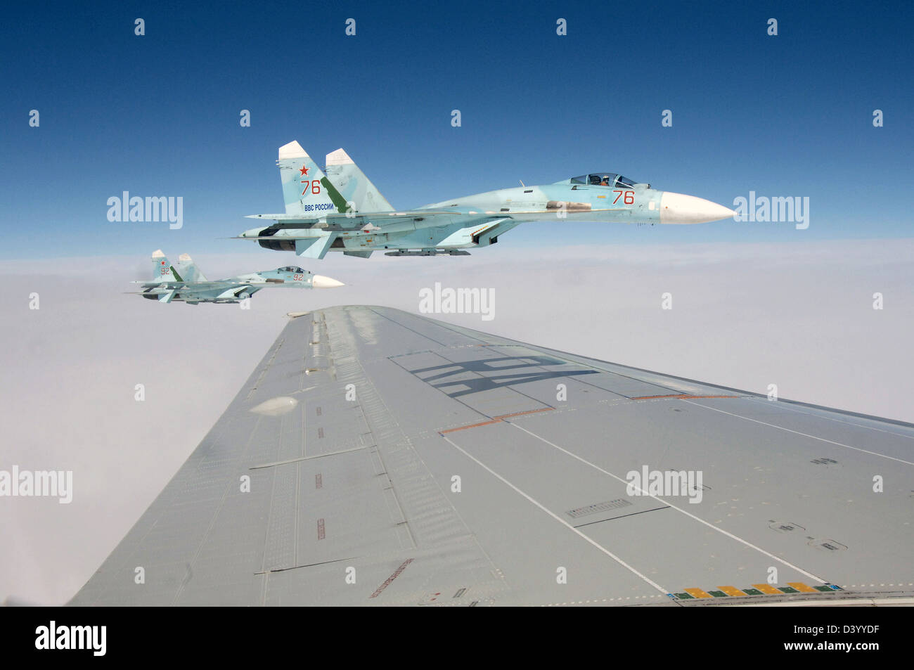 A pair of Russian SU-27 fighter aircraft escorts a simulated hijacked airliner during a joint training exercise - Stock Image