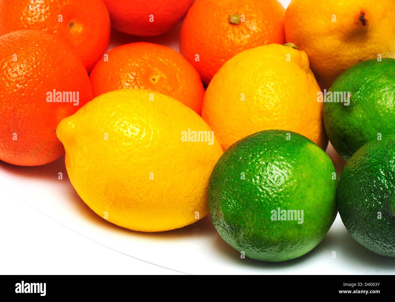 Mandarin oranges, lemons and limes in a bowl. - Stock Image