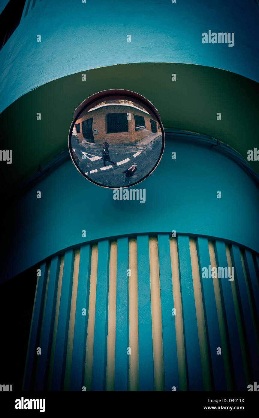 Self portrait in mirror with passerby - Stock Image